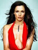 Famke Janssen red cleavage