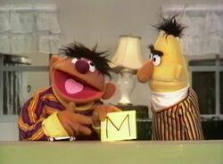 Ernie writes Mort a letter M