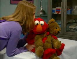 Gina kiss Elmo visit doctor