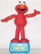 Tara toys push puppet elmo