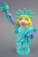 Disney pose piggy statue of liberty