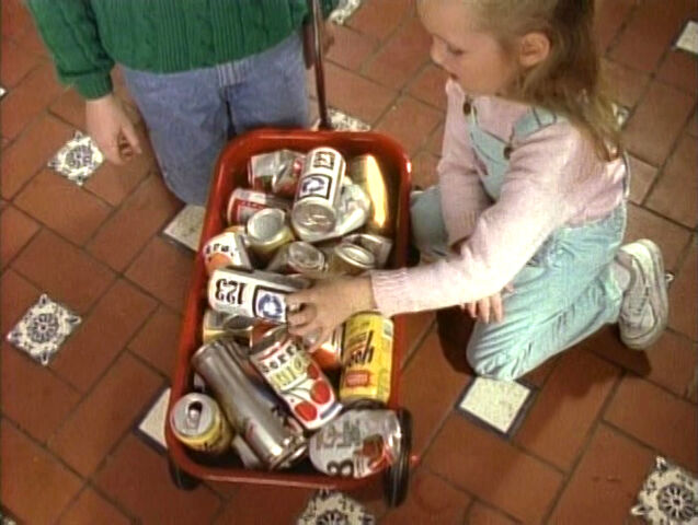 File:Girl-recycles-cans.jpg