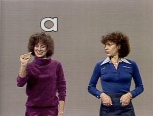 Two Lindas sign the alphabet