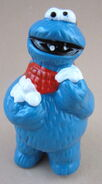 Newcor carolers cookie monster christmas ornament eating snow