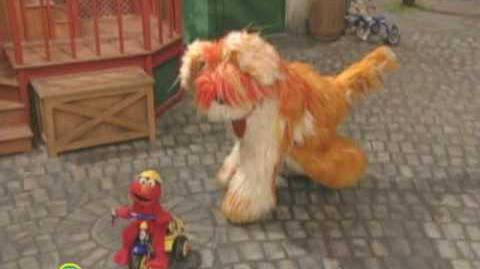 Sesame Street Elmo Riding A Tricycle