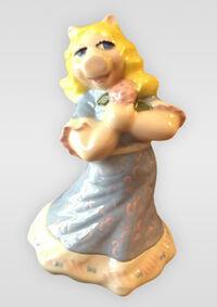 Porcelain-Piggy-holding-flower
