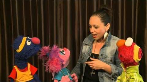 Elmo poses like Usain Bolt plus fun London 2012 interview