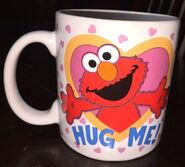 Applause 1997 hug me elmo mug 1
