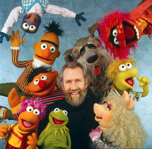 Jim Henson surrounded by Muppets Fraggles Sesame