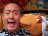 Muppets kissing humans
