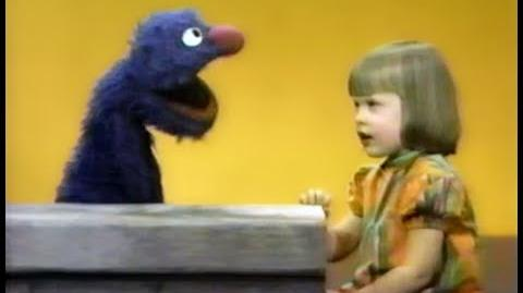 Polly Stone sings the alphabet for Grover
