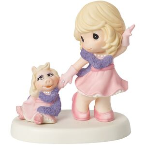 Precious-moments-girl-with-miss-piggy-figurine