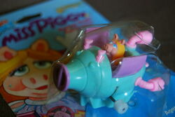 Tomy wind-up flip-flopper swinetrek 2