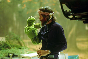 Jim Henson looking at Kermit