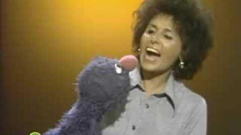 """Sesame Street Lena Teaches Grover To Say """"How Do You Do?"""""""