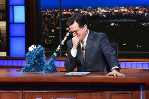 Cookie Monster and Stephen Colbert
