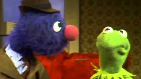 Classic Sesame Street - Constantine and Kermit the Earmuff Salesman