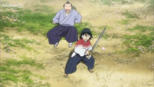 Younger Jinbei protecting the lord son