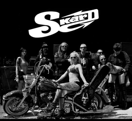 File:Small SKARD rock band with bike STAGE.jpg