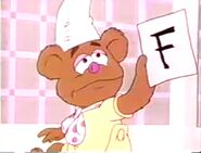 A tearful Fozzie shows Nanny what Piggy did to him by giving him a F on his report card