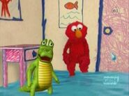 Elmo counts 15 tears coming out from a crying crocodile