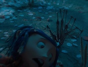Coraline being dragged to her doom
