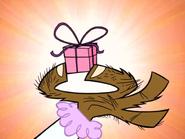 Mr. Mandrill's Handrill Holding a Present