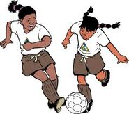 African girl scouts playing soccer