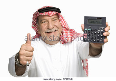 Mature-man-holding-calculator-showing-thumbs-up-portrait-cpgrn0