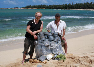 Adam and jamie on the island with a pile of Duct Tape