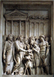 Bas=relief of family group, with an animal, outside large building with columns