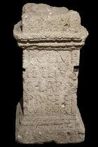 Narrow stone altar, with inscription