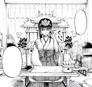 Aiko gets ready to read fortunes