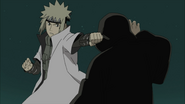 Minato tentando atacar Tobi