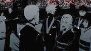 Naruto and Hinata are congratulated by Tsunade