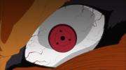 Kurama siendo controlado por el Sharingan de Obito