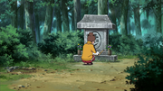 Azami visitando o cemitério do seu avô