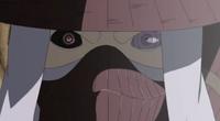 El Sharingan y Rinnegan de Tobi reflejados en los ojos de Han