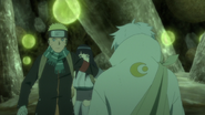 Naruto protege Hinata da marionete de Toneri