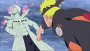Naruto trata de hacer reaccionar a Obito