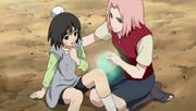Tami siendo curada por Sakura