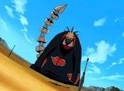 Sasori (Hiruko) pelea con Kankurō