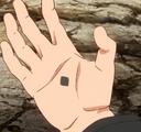Kāma de Boruto en forma de diamante negro en su palma
