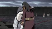 Muku atraviesa el pecho de Mui