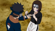 Rin treating Obito's wound.