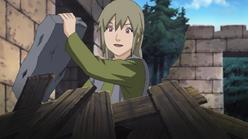 Yukimaru mexendo em escombros