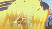 Naruto protege a Sarada con la cabeza de Kurama