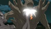 Gyuki e Naruto socam o Gedo Mazo