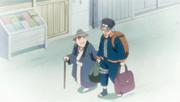 Obito de niño ayudando a una anciana