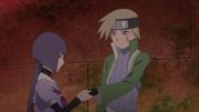 Sumire tending Kagura's wound